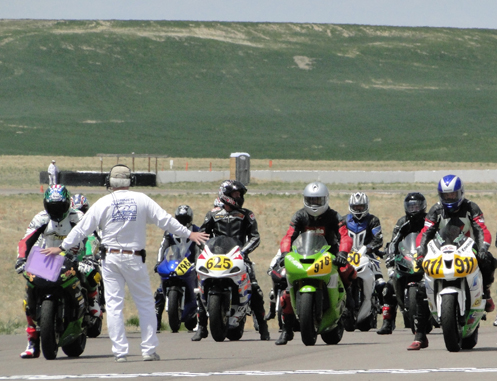 motorcycle racers ready to run