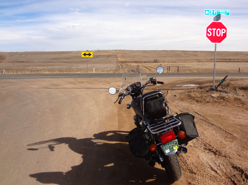 motorcycle at t-intersection out on the prairie