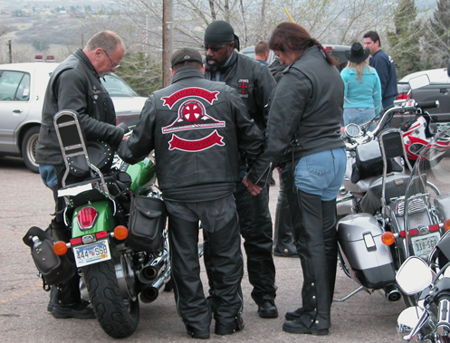 bikers blessing a motorcycle
