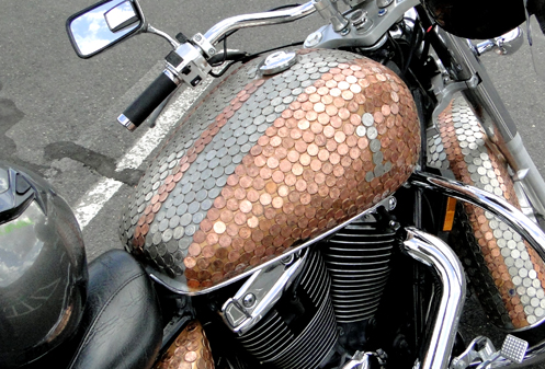 A Harley covered in pennies and nickels