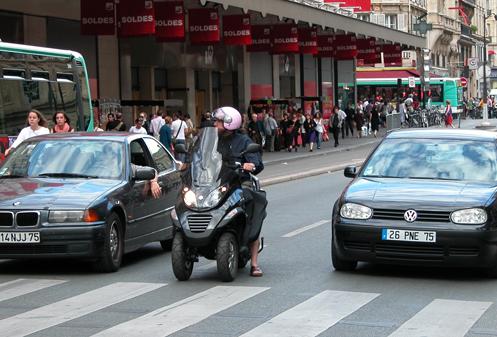 lane-splitting motorcycle in Paris