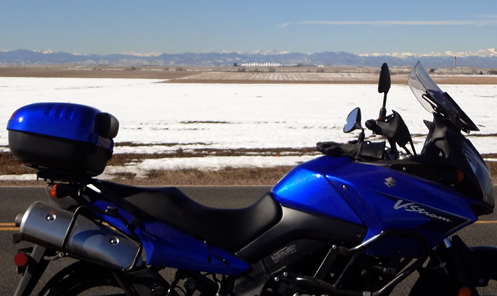 motorcycle with DIA and the mountains in the background