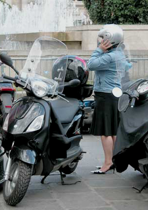 Woman in skirt with scooter