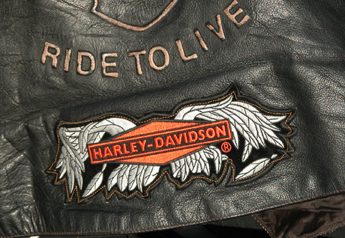 Broken Wings patch on leather vest