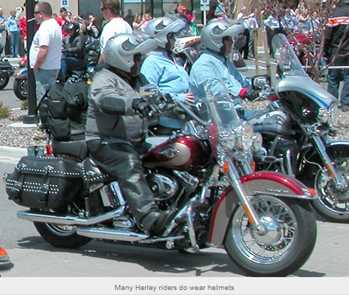 Harley riders wearing helmets