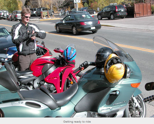 motorcyclist gearing up