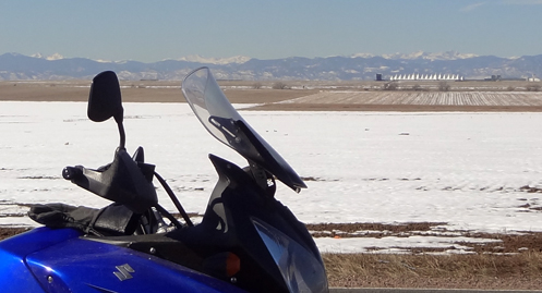 motorcycle with DIA in the background