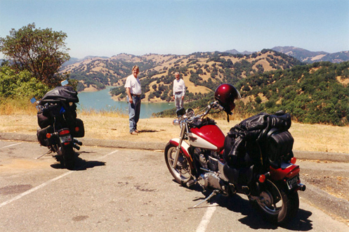 motorcycle above lake